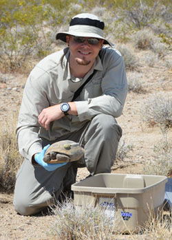 Dr. Todd with a desert tortoise in the Mojave National Preserve